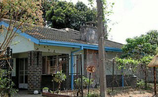 Image result for mugabe house, highfield